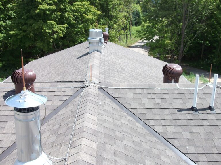 Lightning protection rods on house roof